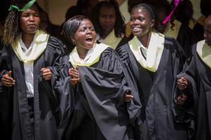 Lillian dancing and singing at her high school graduation. (Photo: Lindsey Minerva/World Vision)