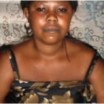 Esther from Ghana received a loan to buy textiles and sewing accessories for designing and sewing garments.