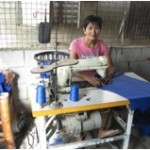 Teresita from the Philippines received a loan to buy a new sewing machine to make bags, blankets and curtains to sell.