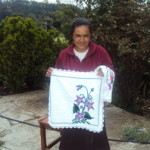 Pascuala of Mexico received $250.00 to buy materials such and cloth, yarn and thread.