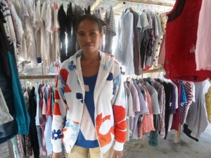Rosaria of Honduras received $1,075 to buy long shorts, short sleeve shirts, and long sleeve shirts to sell in her second-hand shop.
