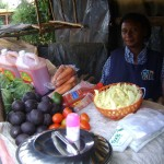 Esther of Kenya received $300 to add stock to her groceries.