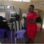 Caroline from Kenya received $175 to rent space to do more computer training in her cyber cafe business.