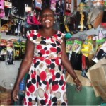 Josinta from Kenya received $90 to buy more stock for her beauty shop and her business selling shoes.
