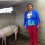 Maria from Ecuador received $1,450 to buy more pigs for her business raising and selling pigs.