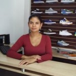 A loan of $900 helped Monica Johana buy a lot more shoes to stock up and to have more variety to offer.