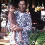 Prom from Cambodia received $250 to increase her farmland for her business selling rice and groceries.