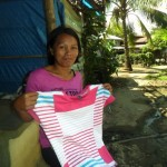 Regina from the Philippines received $125 to buy more clothing to expand her business selling clothing.