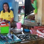 Rosaly from the Philippines received $980 to buy a boat to expand her business selling fish.
