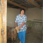 Tamara from Kyrgyzstan received $1,100 to buy stock to increase her herd She has cows, sheep and potatoes on her farm. She also teaches kindergarten.