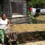 Zencerly from the Philippines received $450 to buy hogs and treats for her businesses raising hogs and selling candy.
