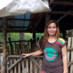 Cecilia from the Philippines received a loan of $100 to buy piglets, feed, and jewelry.