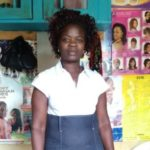 Grace from Kenya received a loan of $815 to add a small shop to sell cosmetic products.