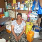 $125 from iZōsh complete a loan of $200 to help Isatu purchase assorted drinks and other provisions to expand her business.