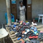 Betty in Uganda received a loan of $200 to increase her shoe inventory in her business in a trading center.