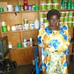 Cate in Uganda received a loan of $150 to buy supplies for her hair salon.