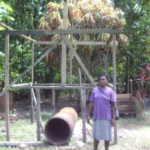 Gladys in the Solomon Islands received a loan of $900 to buy drums, spades, wheelbarrows, and timber to make an additional cocoa dryer for her cocoa drying and selling business.
