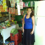 Glenda in El Salvador received a loan of $975 to buy milk, coffee, bread, vegetables, sodas, detergents, and other goods for her store.