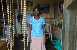 Immaculate in Uganda received a loan of $225 to hire an employee and purchase chickens as another source of income in addition to her hair salon.