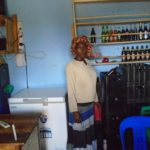 Justine in Uganda received a loan of $175 to buy supplies and increase revenue in her bar in a trading center.