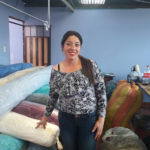 Luz in Columbia received a loan of $1050 to buy rolls of fabric, elastic, appliqués, lace and other supplies for her sewing business.