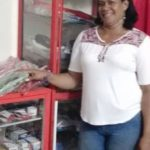 Maria in Columbia received a loan of $225 to buy bulk goods to sell in her general store.