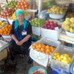 Mehribonu in Tajikistan received a loan of $1100 to buy different fruits to expand her fruit selling business.