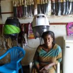 Miriam in Uganda received a loan of $200 to buy hair dryers and supplies for her beauty salon.
