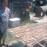 Nora in the Philippines received a loan of $200 to buy supplies for her smoked fish business, and to become a wholesale business.