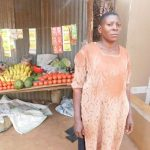 Agaba in Uganda received $150 from iZosh to buy bulk goods to sell in her charcoal and fruit stand.