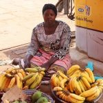 Beatrice in Uganda received $100 from iZosh to buy additional capital for her business selling bananas and raising cattle.