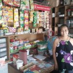 Carina in the Philippines received $200 from iZosh to buy products for her small convenience store.