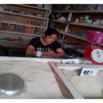 Chat in the Philippines received $250 from iZosh to buy goods to expand her general store.