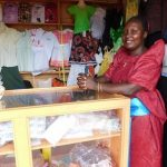 Rebecca in Uganda received $225 from iZosh to buy supplies for her business making clothing for families.
