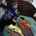 Sharina in Pakistan received $250 from iZosh to buy boutique variety cloth and wedding dresses to sell from her home.